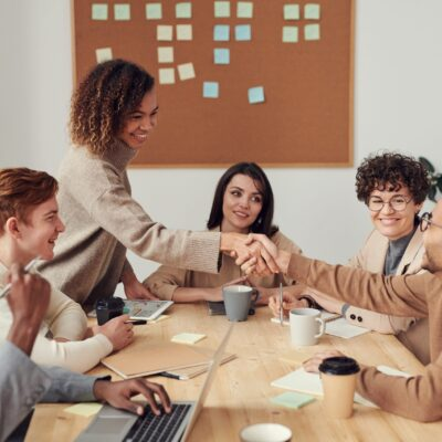 A mixture of people collaborating in a classroom setting