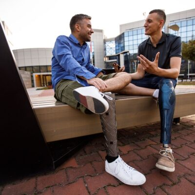 Personal Resilience - men with leg prosthesis sharing personal experiences